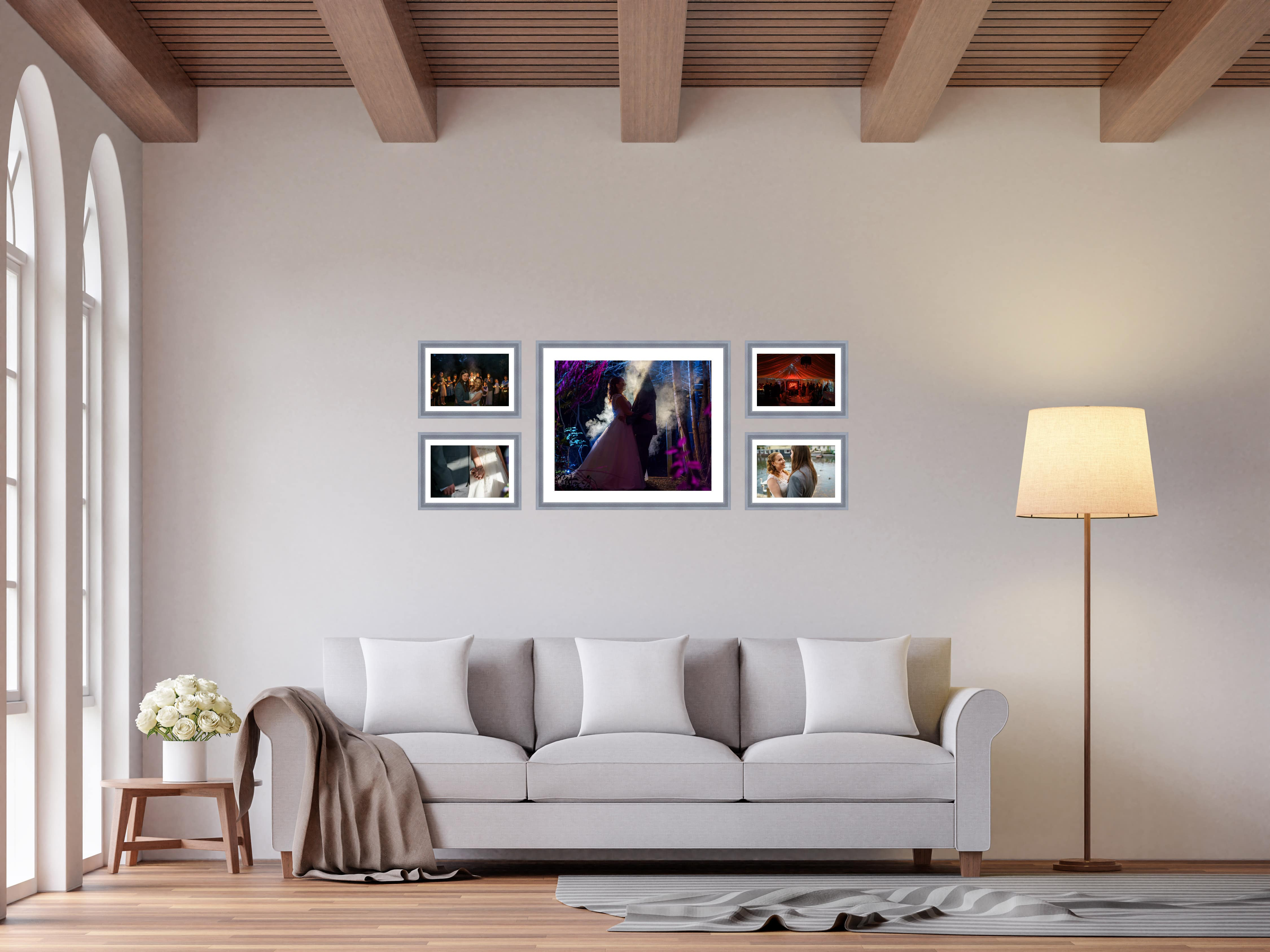 Scandinavian living room 3d rendering image.The Rooms have wooden floors and ceilings with white walls and arch windows.The room is furnished with light grey fabric sofas.