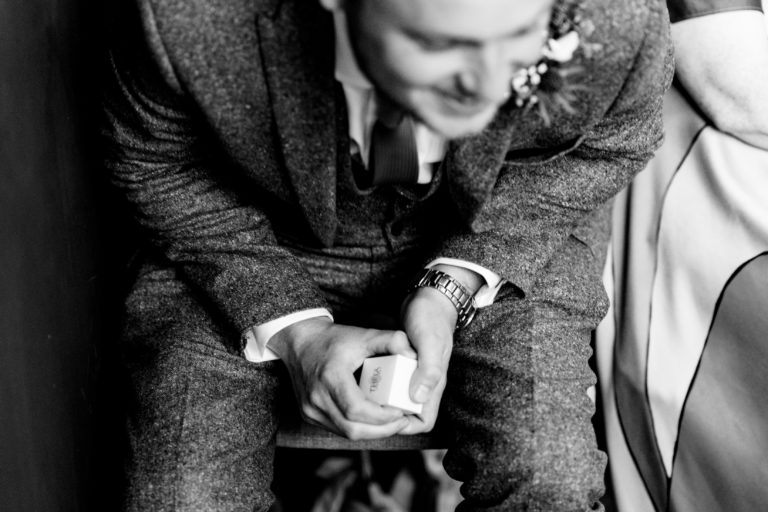 best man keeping a tight hold of the rings - norwich wedding photographer