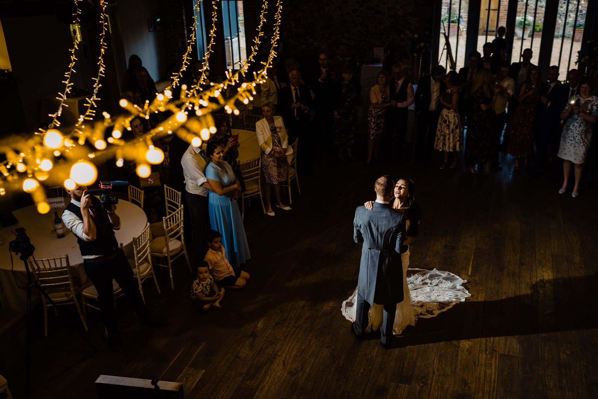 bride and groom dancing at oxnead hall wedding, framed by fairy lights
